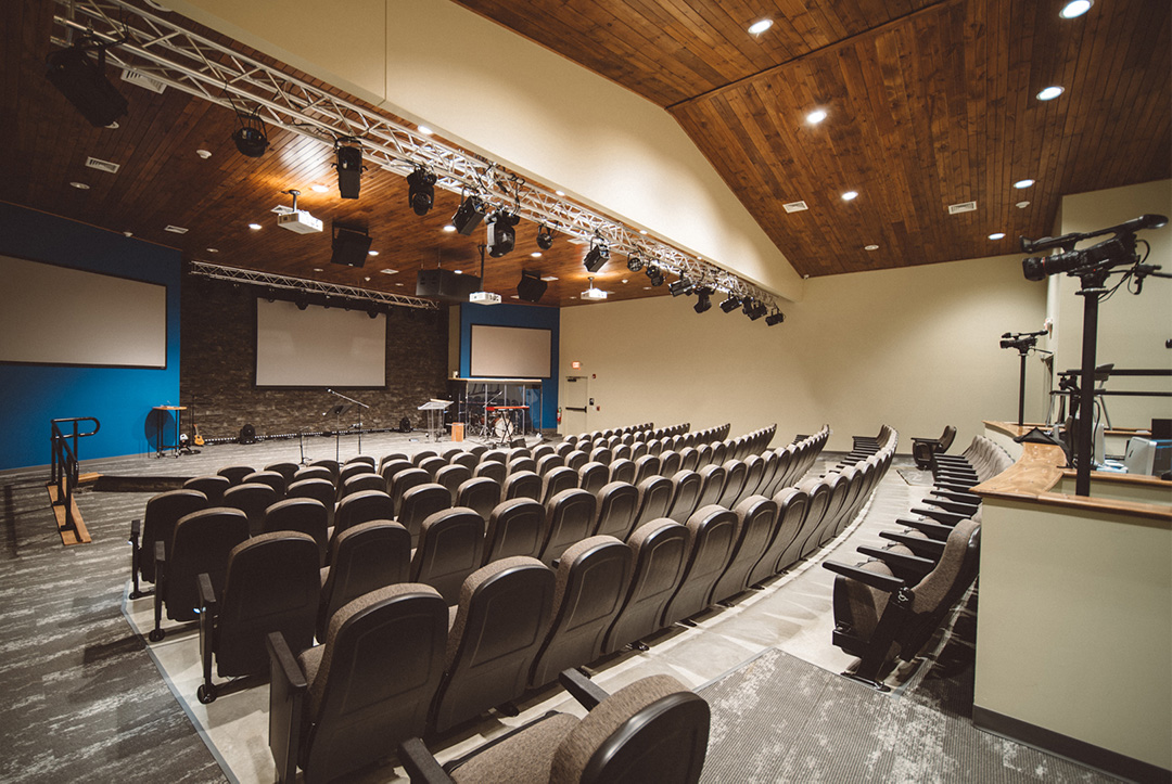 150 seat youth ministry auditorium equipped with modern lighting, audio equipment, and cameras