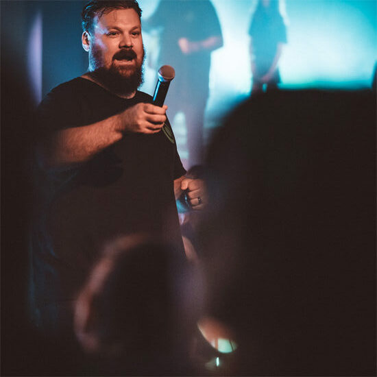 West Ridge Church's Student Ministry Pastor Bryan Burns hyping students before worship